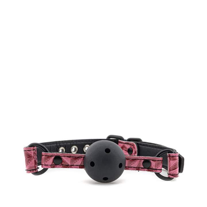 Czarno-różowy knebel kulkowy oddychający z ozdobnym paskiem